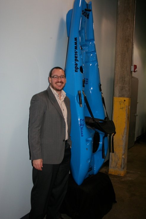 Professor David Ringholz, in front of a student project, sponsored by Hobie.