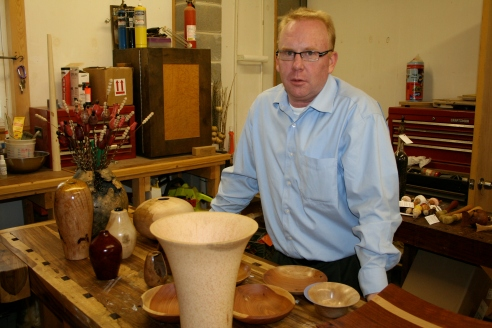 Tom Gattis, head of the Industrial Design Department. He's an expert wood turning craftsman in his spare time. The vase in front is made from the local palm trees.
