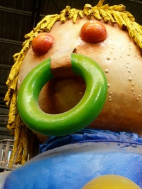 It's a blast to tour the year-round backroom studios of the enormous Blaine Kern workshops, where they start building the next year's floats the minute Mardi Gras ends. But this scary doll sporting a weird pacifier and acne could not be explained by our tour guide.  It must have inspired many a nightmare as this giant water head lumbered slowly down the parade route.