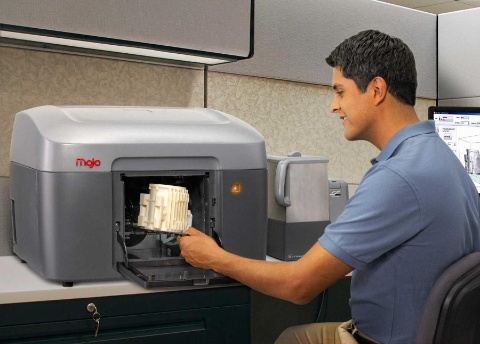 The newly released Mojo professional grade 3-D printer by Stratsys.  It's available for $9,999, or by lease for $189/mo.