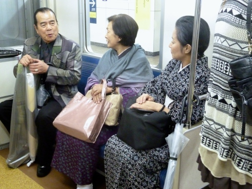 Two ladies in everyday kimonos on the subway.  I learned that younger women will make an appointment and pay $300 to get help with being dressed for a formal occasion in a kimono.