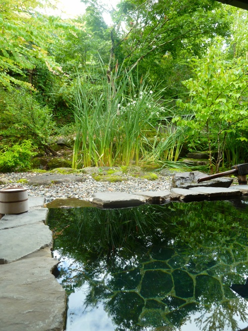 Beyond the sheer relaxation, sleeping on tatami mats, and the special food, a key reason to stay at a ryokan is their hot springs baths, called onsen.  This is a view of a private one.
