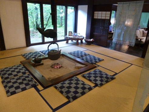 "This is an old traditional Japanese kitchen, in the entrance to the Alps ryokan.  If you get to see the new Japanese move ""Oshin"" (based on an old popular TV series) it features a lot of these kitchens and is a really lovely film."