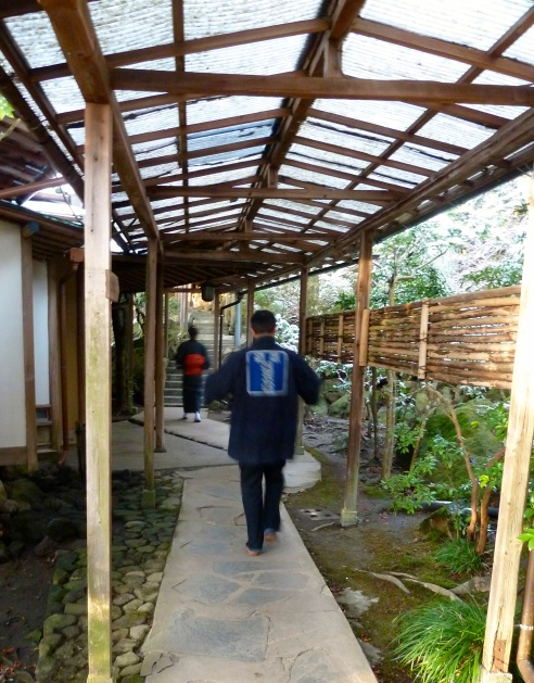 Some of the accommodation is reached by covered foot paths.  These are two workers delivering early morning breakfast courses.