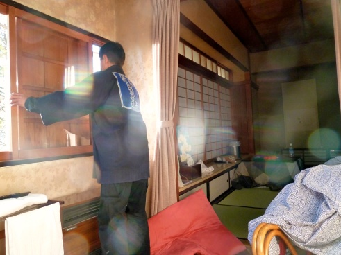 The biggest thing you have to get used to in a ryokan is the staff coming in your room nearly at will.  Here is our twice daily visitor who handled the wooden window shutters.
