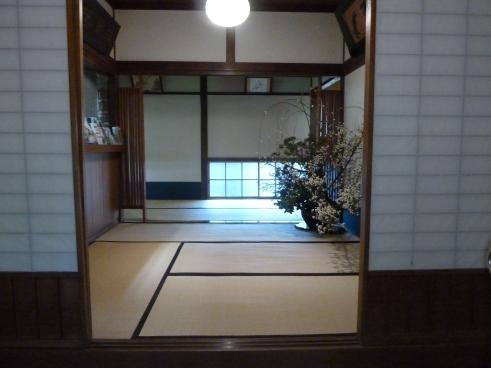 Entrance to the Hakone/Mt. Fuji area ryokan.  Note the gorgeous seasonal greens and flowers arrangement.
