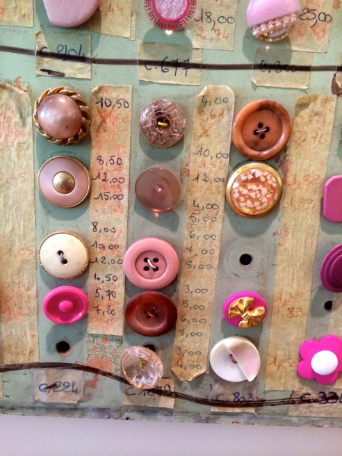 My favorite pieces were a collection of French button samples that were previously used by salesmen to show their wares.  I spoke with the owner who told me he found the collection of six large wooden panels in an antique shop in Wiscasset, Maine