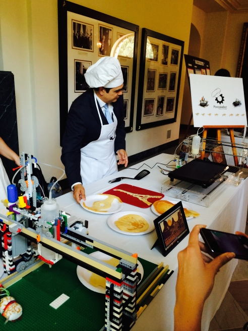 "Here is a ""Pancake Bot"" making 3-D printed pancakes.  Note the Eiffel Tower."