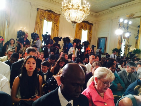 Note the press of, well, press behind the crowd eagerly awaiting the POTUS.