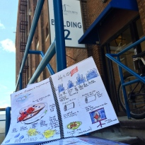 My family vacation journal in front of AB Printing's building