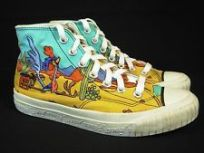 Road Runner and Coyote scene on women's sneakers