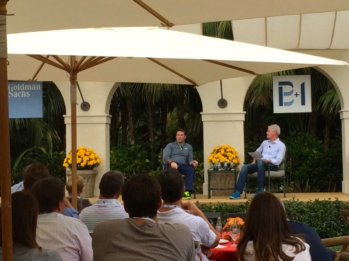 Kevin Plank on left, being interviewed at the Builders + Innovators event